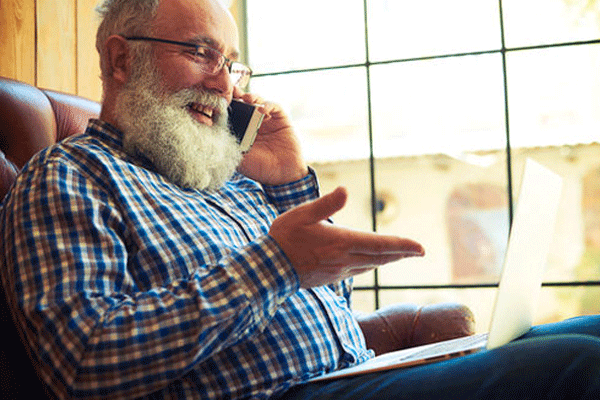 older man on the phone with a white beard asking for support