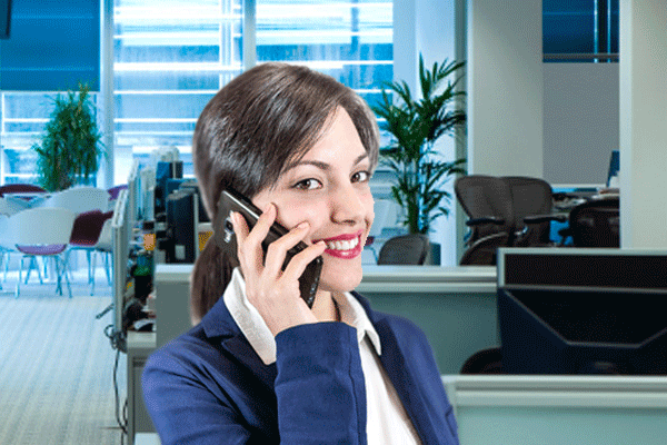 woman on the phone in her office doing business